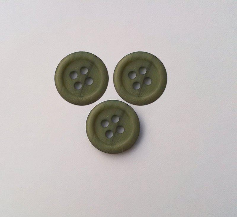 Bouton à quatre trous chiné vert