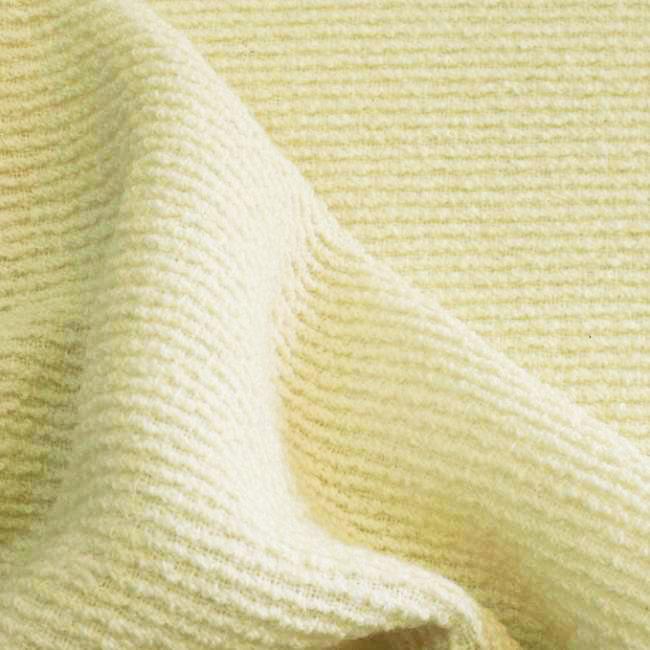 Tissu écru effet tweed douillet