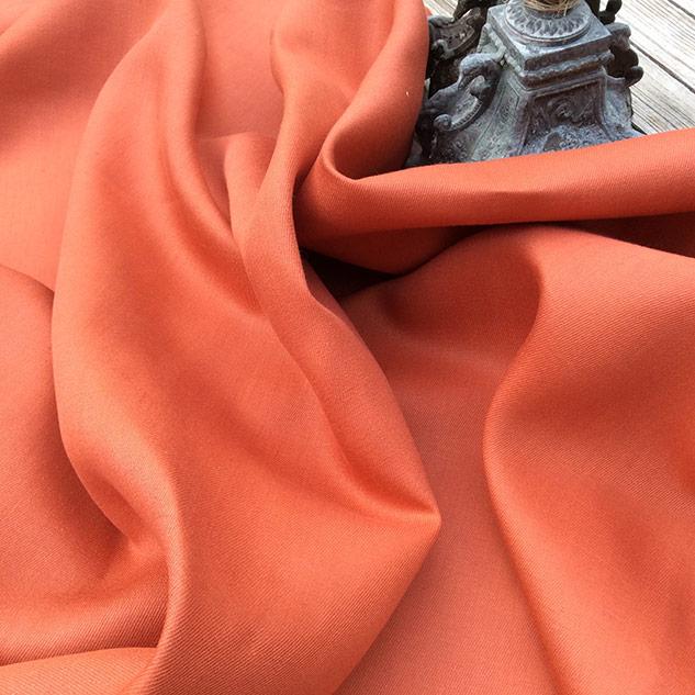 tissu orangé rouge
