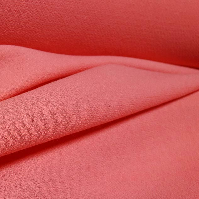 tissu crepe de laine corail