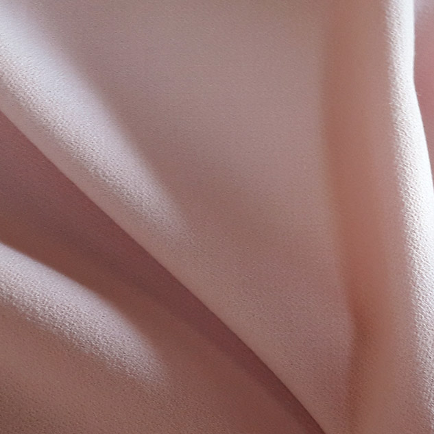 tissu crepe de laine rose