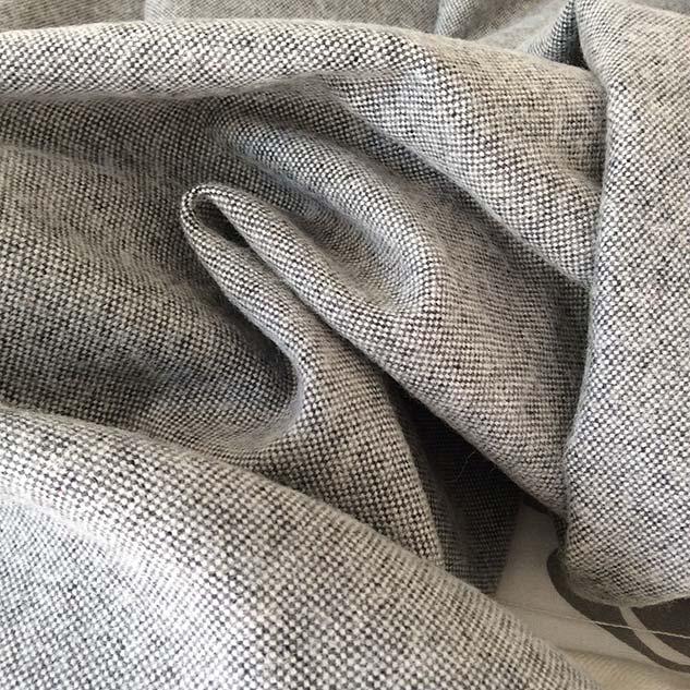 tissu faux uni noir et blanc