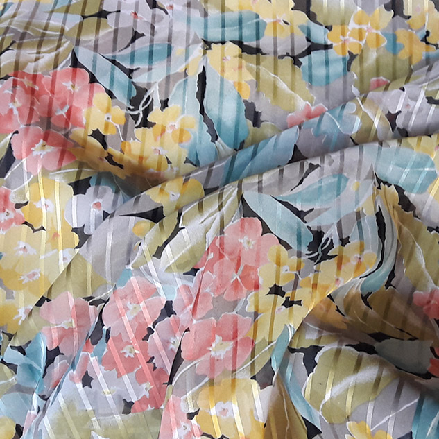 Tissu polyester imprimé fleuri corail