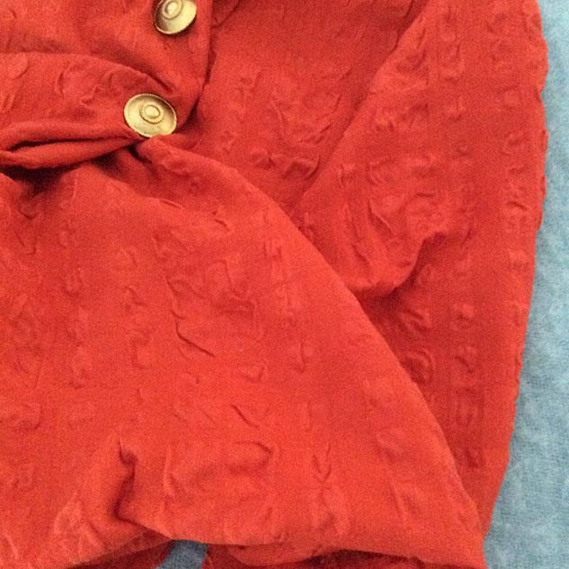 tissu rouge orangé cloqué cardailhac