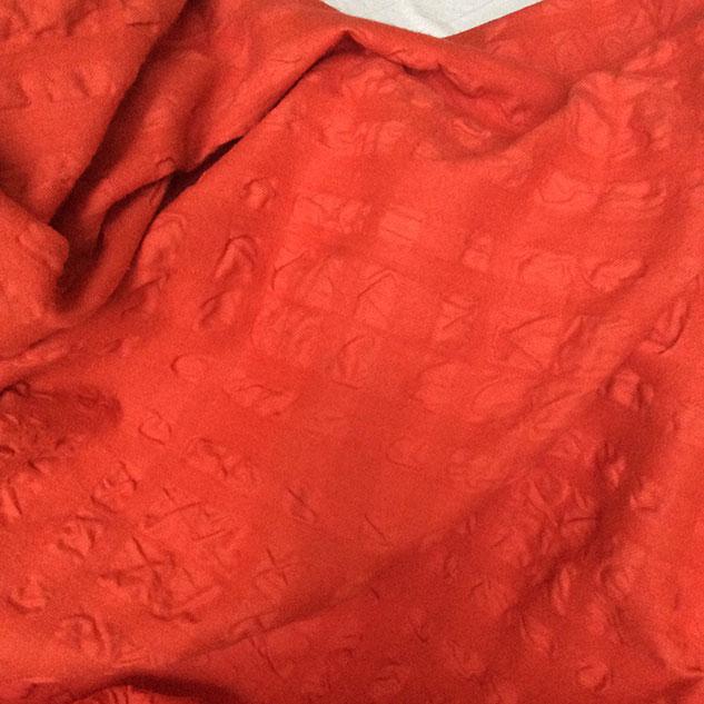 tissu capucine cloqué