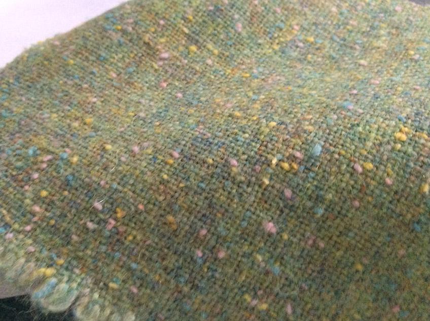 tweed en laine vert chiné boutonné