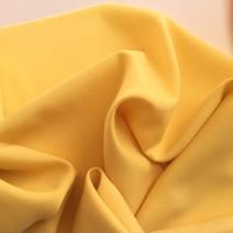 Tissu de laine crêpe envers satin jaune pour pantalon, jupe, robe droite