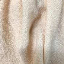 Tissu laine bouclettes rose poudré