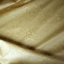 Tissu coton brodé enduit